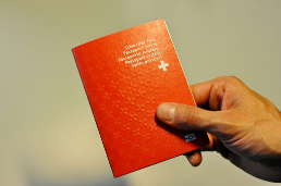 Hand holds Swiss passport